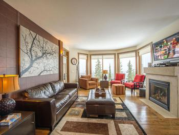 The living room with exposures to the south east is bright and comfortable. Gas fireplace to keep you toasty warm.