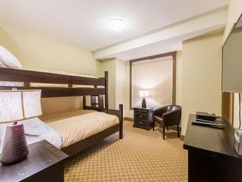 Spacious bedroom with single over Queen bunk bed , 42 inch TV and PS3 game station. Located off the main entrance, adjacent to the four piece bathroom.