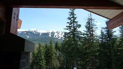 View of the slopes from the deck with the BBQ located off the living room and kitchen