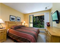 The master bedroom includes a comfortable queen size bed, flatscreen television and adjacent on suite bathroom.