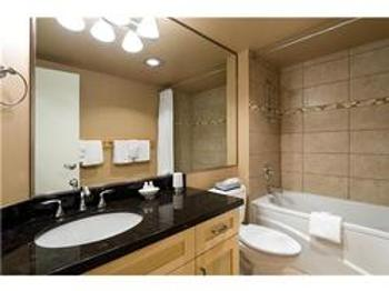 The newly renovated guest bathroom has a large tub, heated tiled floors and a hair dryer.