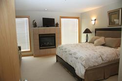 Spacious Master Bedroom with King bed, fireplace sitting area and great view.