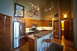 Kitchen with has a gas stove and is fully equipped with small appliances and culinary needs.