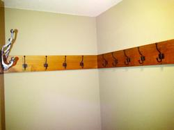 Main entry coat room with 20 hooks for jackets and backpacks.