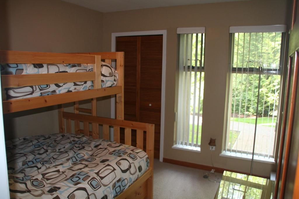 Second bedroom with double bed, single bunk.