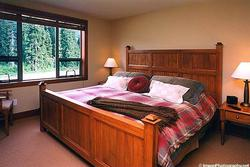 MASTER BEDROOM: King Bed. Armoire w/TV, Telephone, Large Closet, In-Suite Bathroom w/double headed Shower.