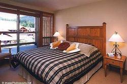 QUEEN BEDROOM: Queen Bed, Private Balcony, Armoire w/TV, Large Closet, Telephone and plenty of room for a Port-a-Crib.