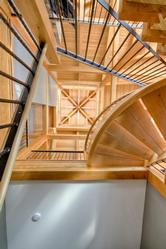 View from the ground floor following the winding staircase up to the magnificent timber ceiling.