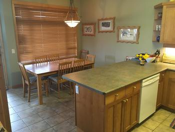 Dining area - table expands to seat up to 8 and room for three at the counter