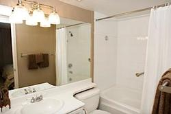This is the Ensuite bathroom off the Master Bedroom featuring a full size bath. The bathrooms have both been refurbished, and have chocolate brown fluffy hotel quality bath sheets. Our housekeeper will leave complimentary amenities, and there is a hairdryer provided.