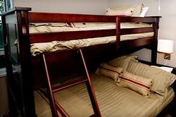 With brand new bedding in 2012, the double bunk below, and single bunk above is perfect to accommodate a couple, singles, or children. there are massive mirrored sliding doors revealing excellent wardrobe storage, and the room also boasts a flat screen TV with Cable channels.