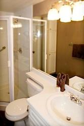 The Main Bathroom with a shower leads off the hall, and has beautiful hotel quality chocolate brown bath towels, and complimentary amenities.