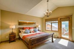 Comfortable king size bed in the upstairs master bedroom.