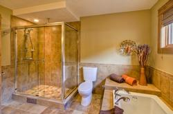 Relax in the soaker tub or enjoy the rain shower in the master ensuite.