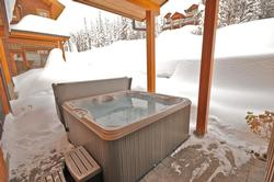 Relax in the hot tub after a busy day on the slopes.