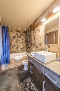 Main bathroom with bathtub can be accessed from the second bedroom or the main living area.