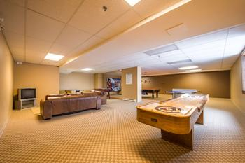 Large games room with shuffle board, pool table, air hockey and a TV- lounge area is located on the ground floor.