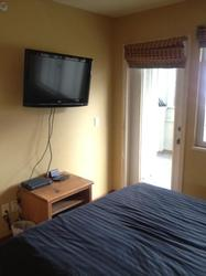 Second bedroom with patio, TV, digital Optic TV.