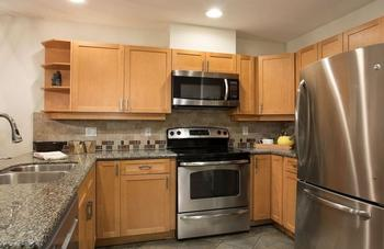 Renovated kitchen: granite counter tops, stainless steel appliances, heated slate flooring and all the requirements to prepare and serve small to large meals.