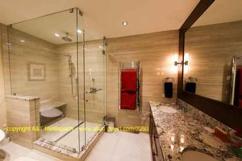 Master Bathroom (Nr 1) with spacious shower, towel heater and Japanese toilet seat