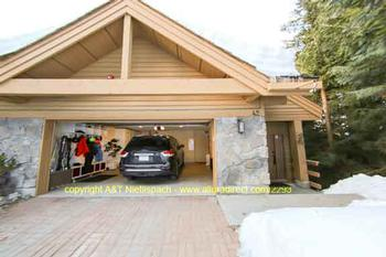 Spacious garage (2 cars) with storage space for skis, ski boot and glove dryer. On drive way also space for 2 cars