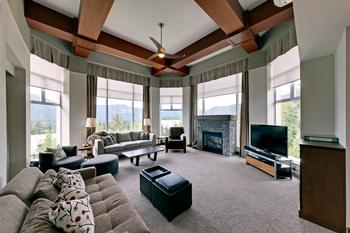 Fabulous round great room tower with floor to ceiling windows. There are drapes and also remote controlled blinds. Press a button and down they come