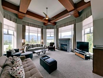 Enjoy spectacular views from floor to ceiling windows in our living room. There are remote controlled blinds. Press a button and down they come!