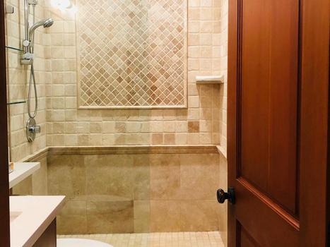 Bathroom with heated floor, oversize towel rails and walk in shower