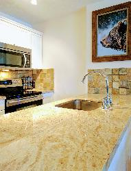 Granite counter tops and stainless-steel appliances add to the luxury feel in the fully equipped kitchen