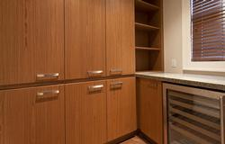 Large pantry located off the kitchen with wine fridge and plenty of storage space.