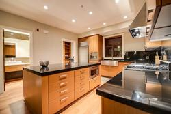 Large modern kitchen - with pantry / wine fridge and powder room located off the kitchen area