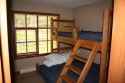 Bunk room with single over queen bunk