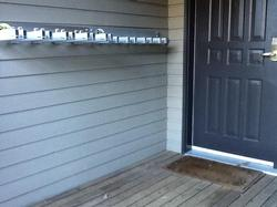 Secure lock system for skis and snowboards outside the front door.