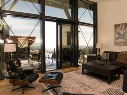 Bright open floor plan with large windows framing views of the mountains.
