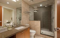 Full bathroom located on the ground floor including heated flooring and a steam shower! Direct access from the fourth bedroom and the common area.