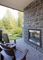 Outdoor fireplace - located on the patio next to the outdoor private hot tub.
