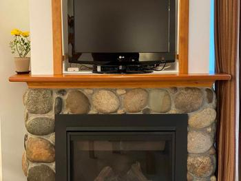 Electric fire place with tv unit above