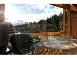 Sunny deck with patio furniture and a BBQ