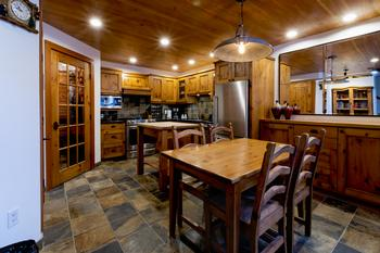 Charming chefs kitchen with distressed pine wood. Remodeled with high quality finishes by a local craftsman. Kitchen is fully stocked with all the culinary equipment you'll need