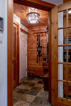 Front entrance includes a place to sit and remove your gear. Floor and baseboard heating will ensure your gear is dry, warm and ready to go the next day. Washer and dryer for your laundry needs is located behind the wooden slat door.