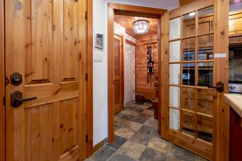 Generous size master bedroom features a custom made queen bed with views of living room below and trees facing Blackcomb Mountain's Wizard chair. Watch television or DVD from your bed. Closet with full length mirror doors is located to the left of the bed.