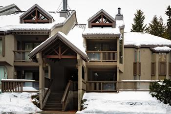 Townhome is located in The Gables right at the Blackcomb base. Blackcomb base sign is visible in the photo