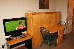 Double Murphy Bed with brand new mattress and topper transforms into dining table HDTV and cable