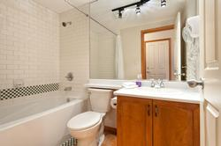 Full Bathroom with sink, bathtub and shower, hair dryer, whisper quiet fan, great lighting, shampoo and conditioner, bar soaps and liquid soap provided, and new toilet.