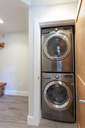 Private washer and dryer located in the front hallway area