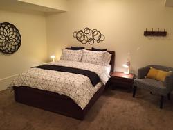 Large ground floor bedroom with queen bed including pillow top mattress for extra comfort.