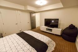 Queen bedroom with 55 inch TV and digital cable.