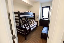 Bunk room 1 is located on second level and includes single over double bunk bed.