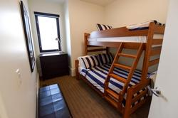 Bunk room 2 is located on second floor with a single over double bunk bed.