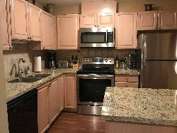 Open kitchen with new stainless steel appliances and everything you need